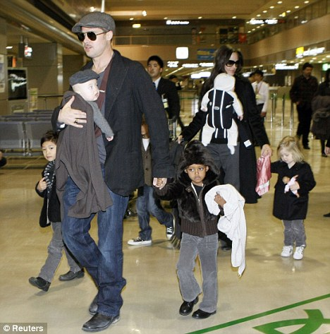Brad and Angelina with their family at the Airport