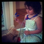 My daughter playing vets at home.