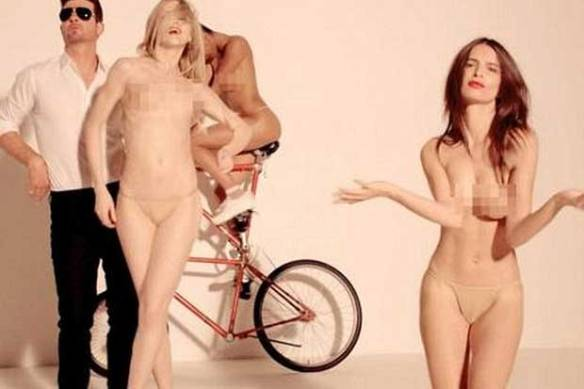 Naked Women. Everywhere. (But of course Thicke is dressed)